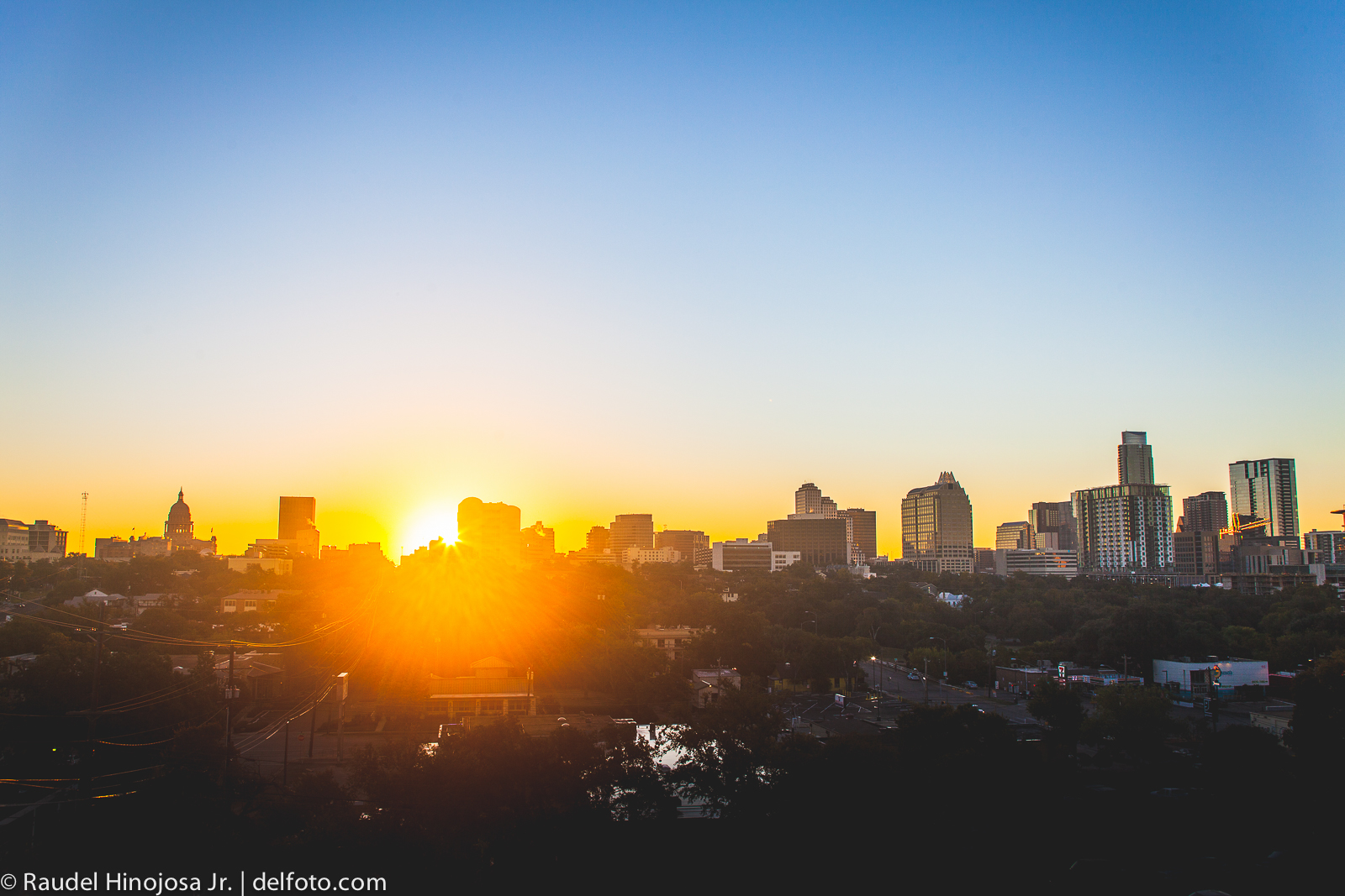 sunrise in downtown austin texas city urban landscape sunburst