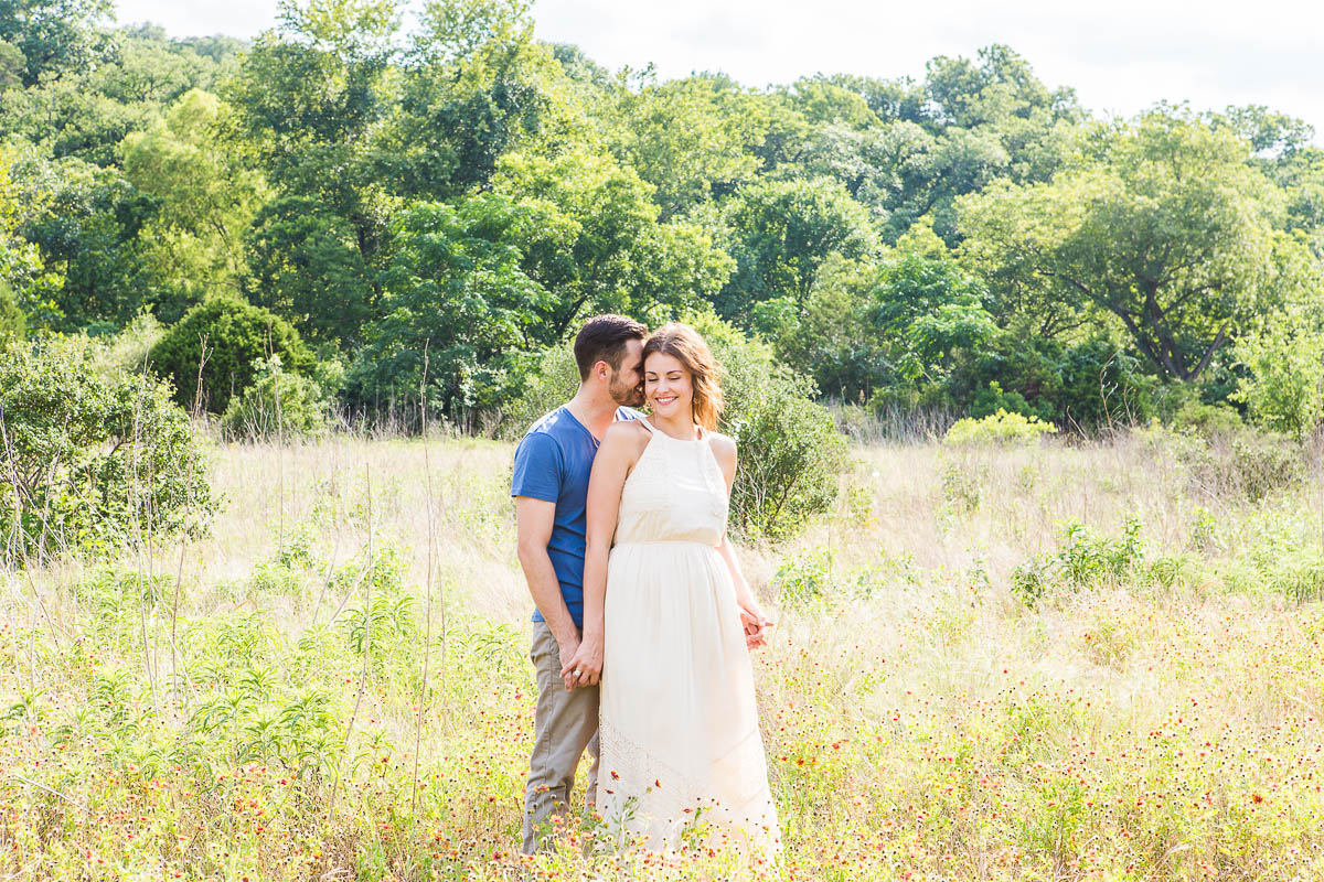 engagement portrait wildflowers nature flowers austin wedding