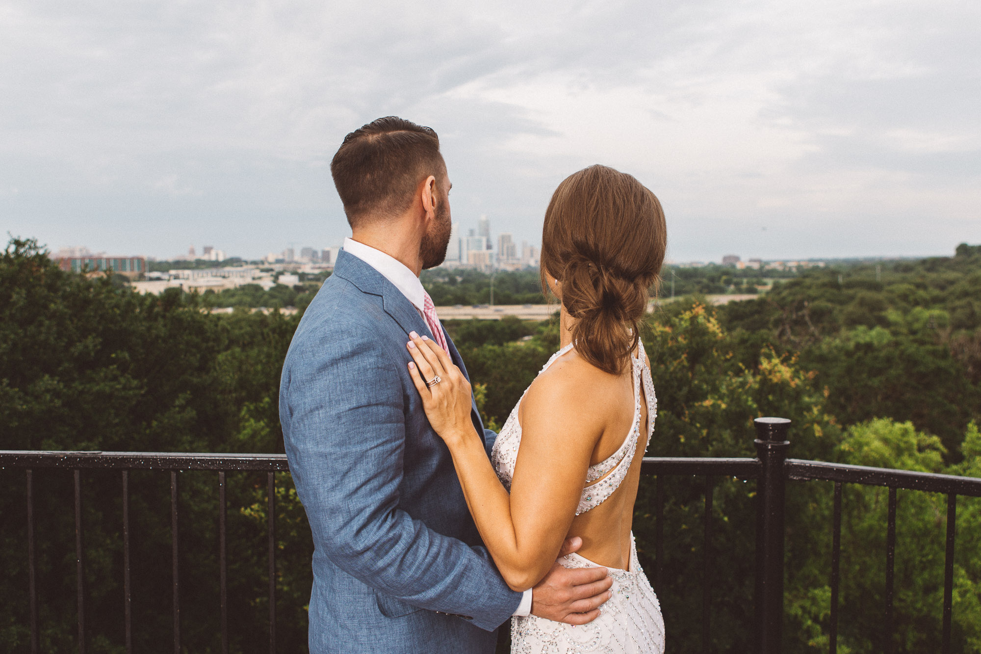 austin texas wedding zilker park clubhouse photographer portraits bride groom kiss pink tie blue suit dapper
