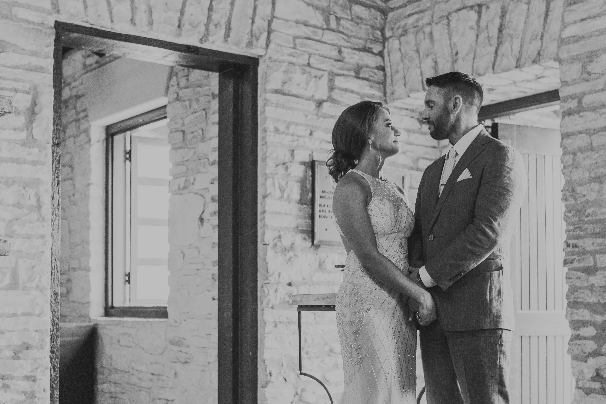 zilker park clubhouse austin texas wedding photographer portraits bride smiling admiring groom mirin happy joy pink tie blue suit dapper