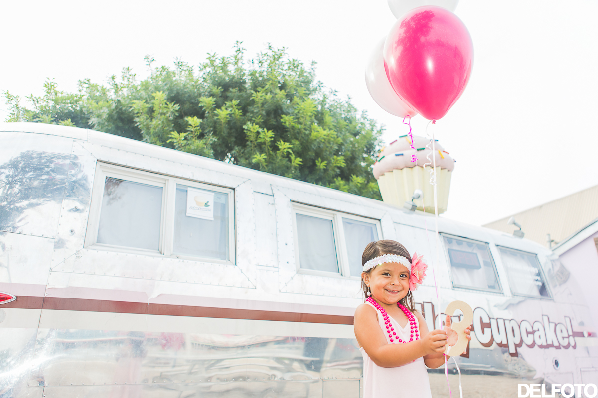 birthday third austin texas soco south congress portrait child children portraiture photographer hey cupcake cup cake food trailer pink balloon balloons