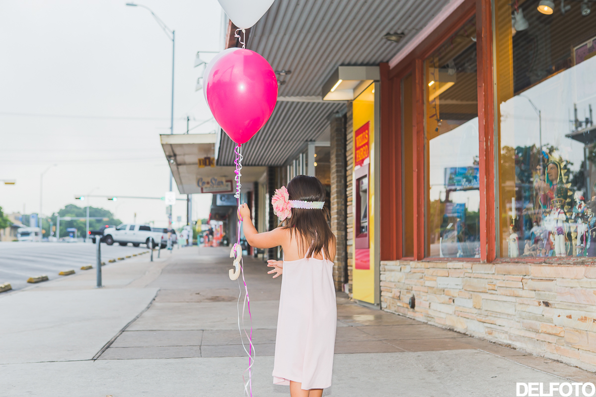 birthday third austin texas soco south congress portrait child children portraiture photographer balloon balloons pink