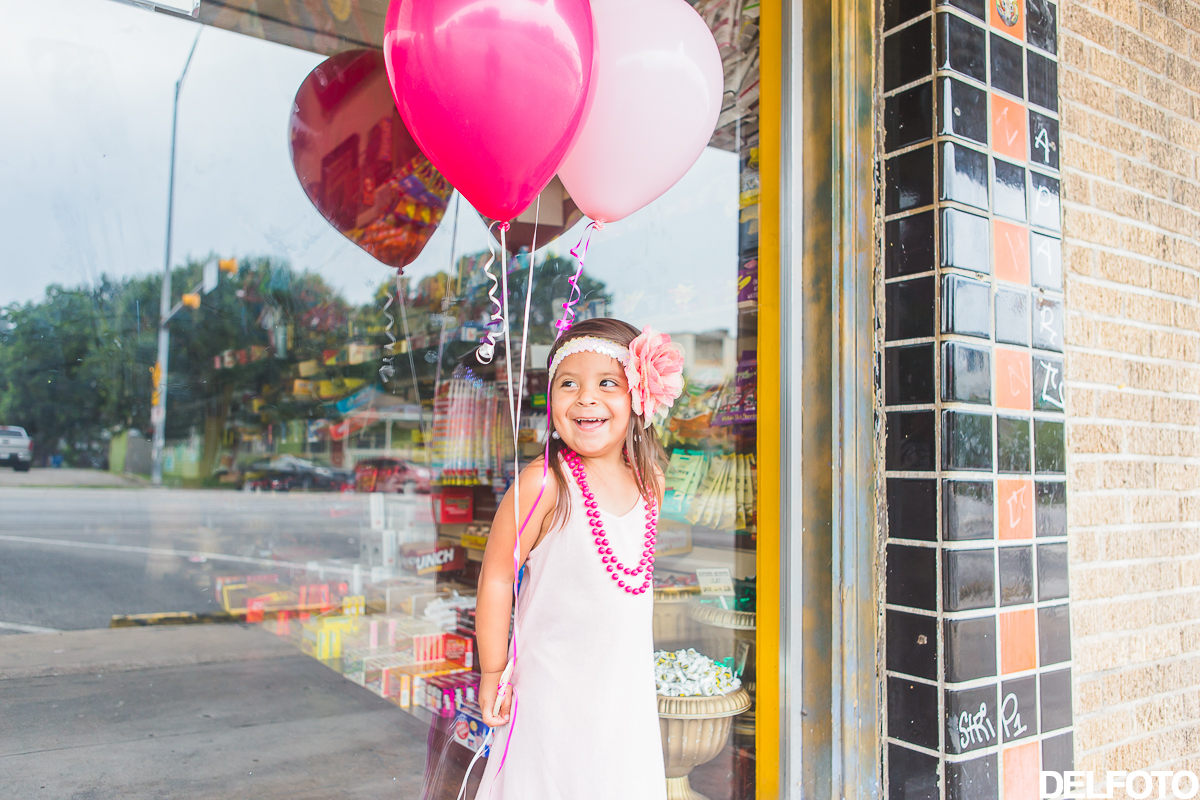 birthday third austin texas soco south congress portrait child children portraiture photographer balloon balloons pink candy store confectionary shop