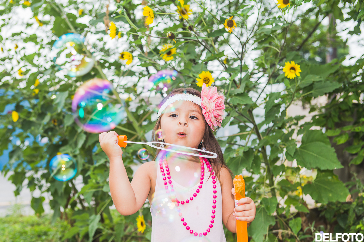 birthday third austin texas soco south congress portrait child children portraiture photographer sunflower green summer bubbles bubble