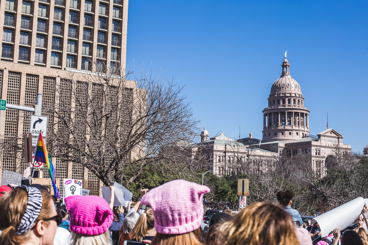 Women's march with the state capitol building in the background