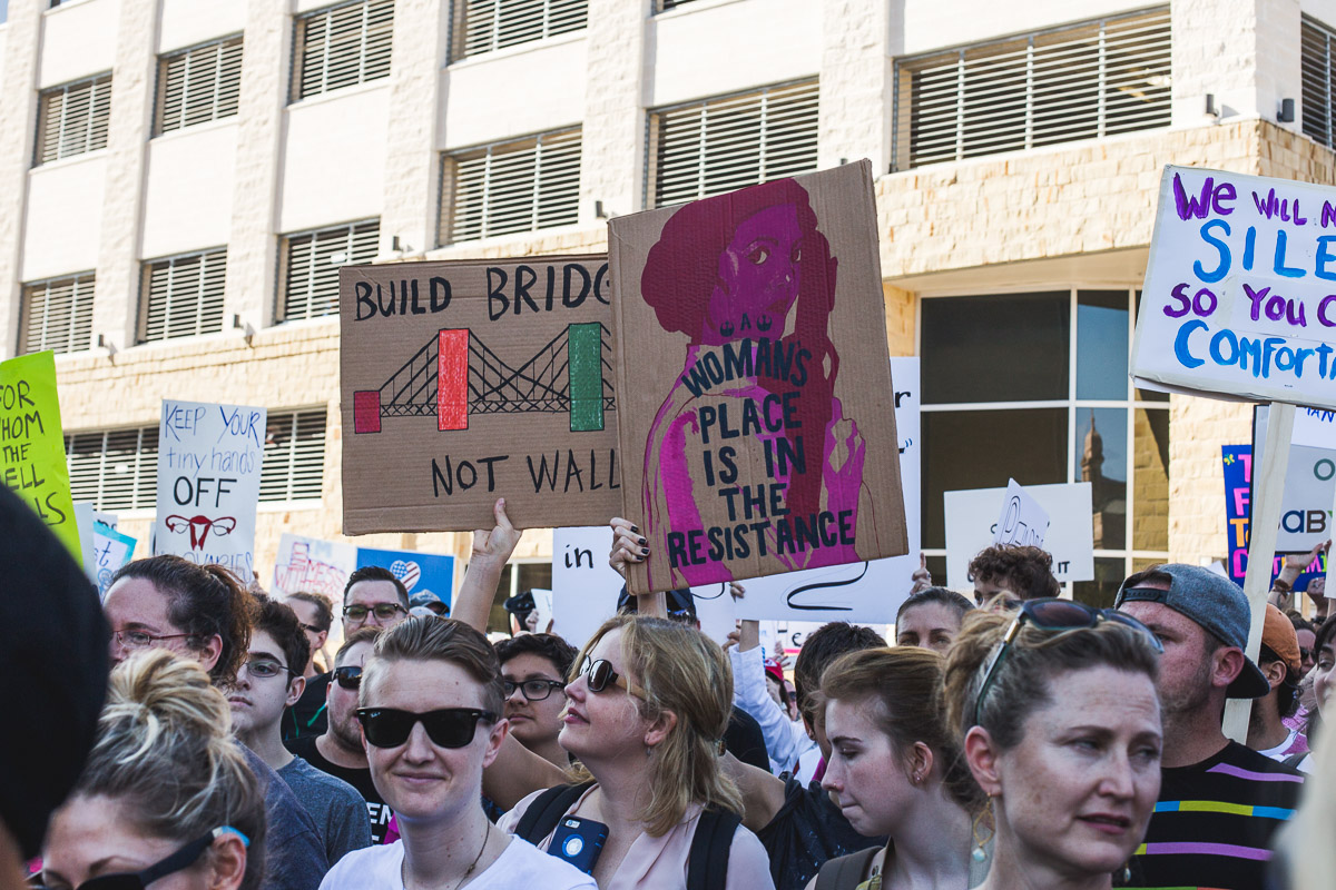 austin women's march participants and friends with signs
