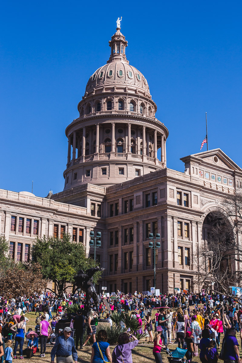 Texas capitol building with women's march on austin protesters