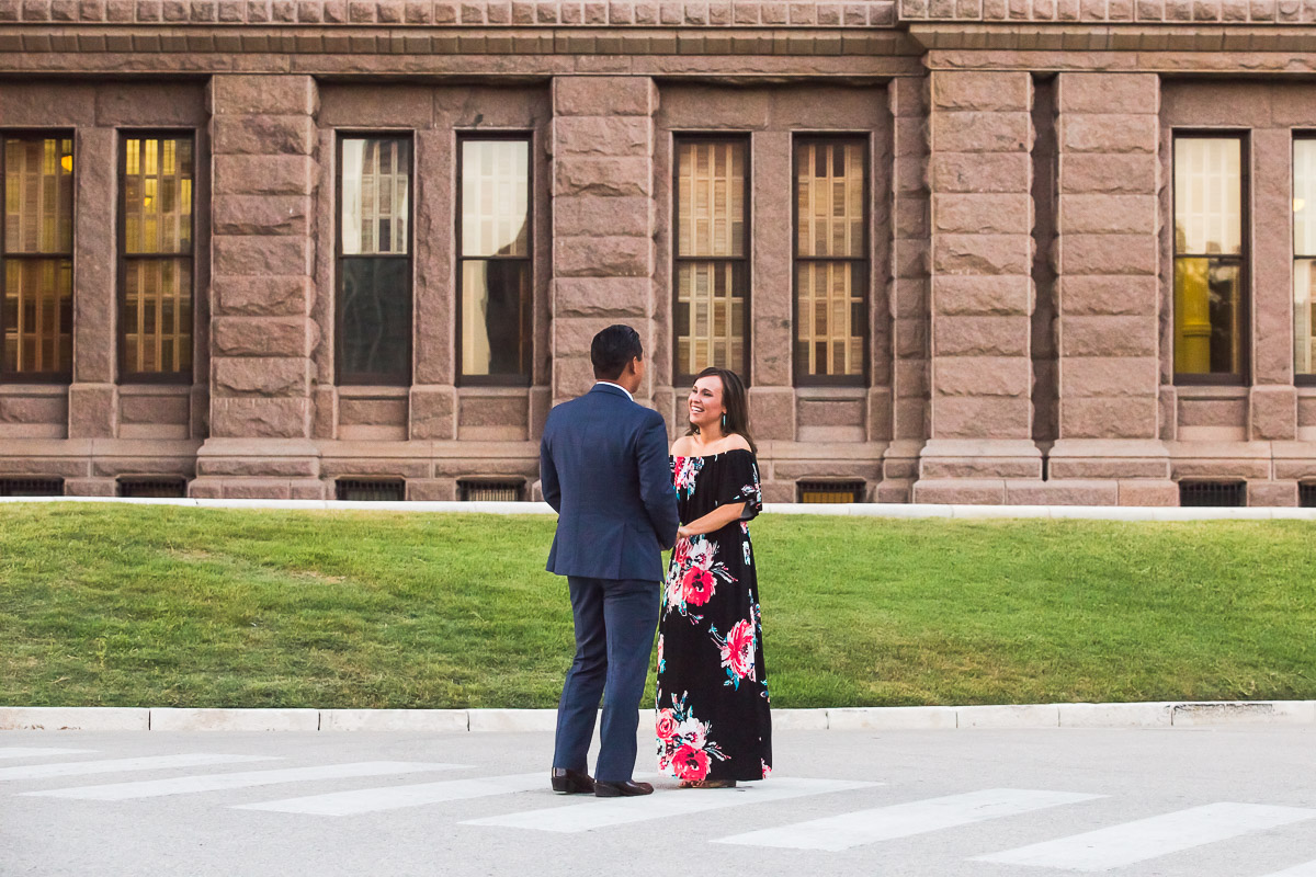 couple holding hands engagement proposal austin texas state capitol