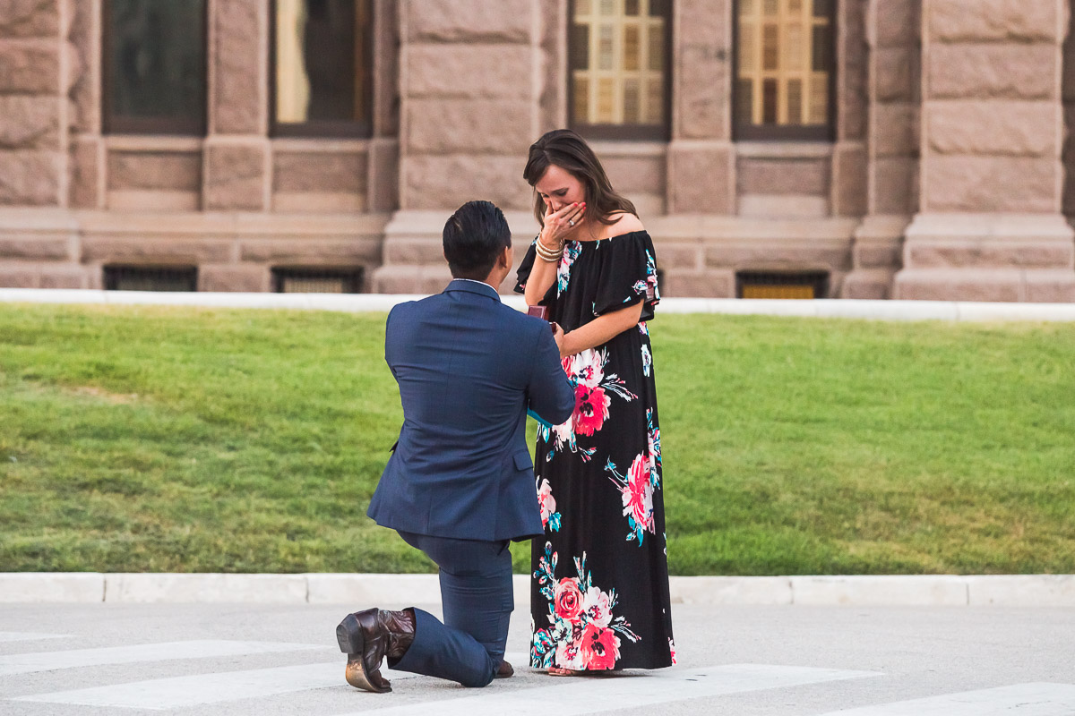 down on one knee proposing engagement proposal austin texas state capitol