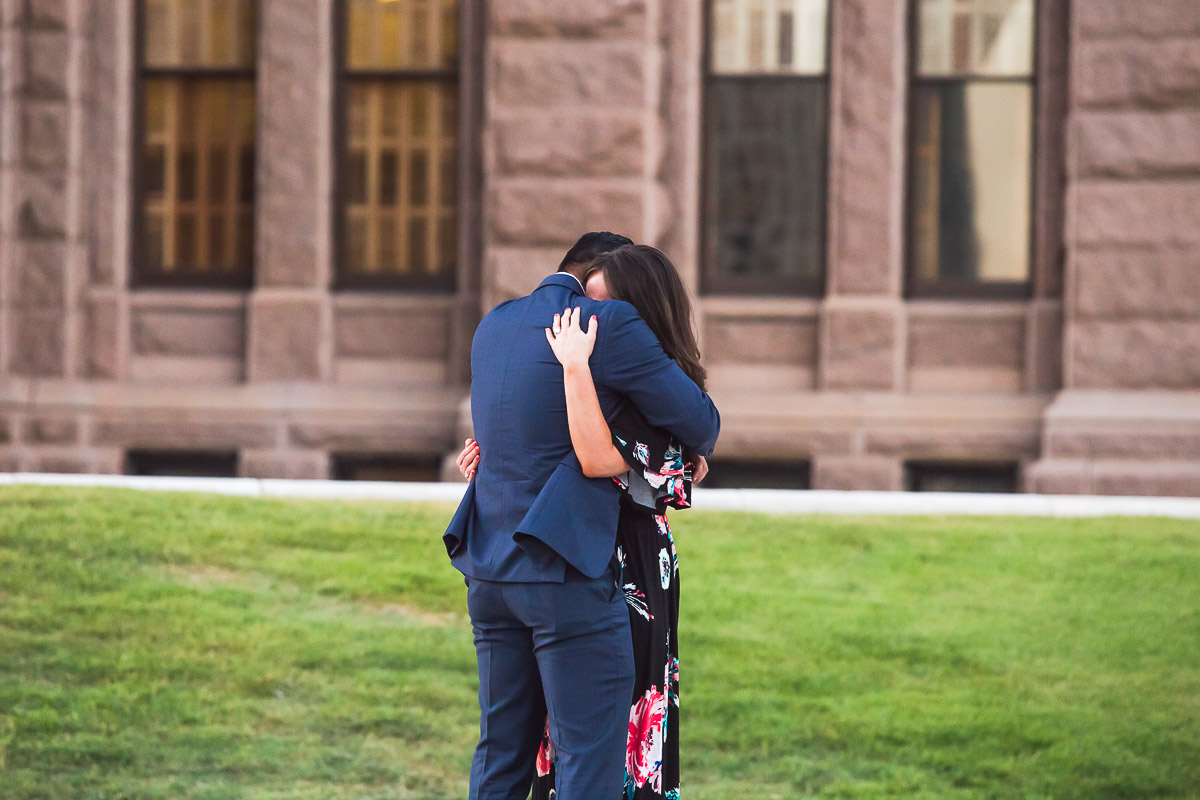 newly engaged hugging happy joyful couple austin texas state capitol