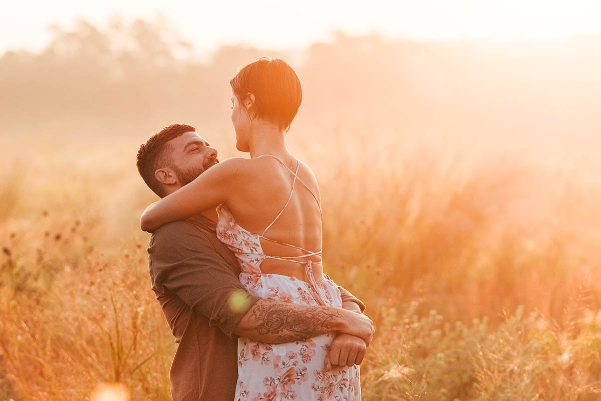 engaged couple hazy sunrise commons ford park engagement photography