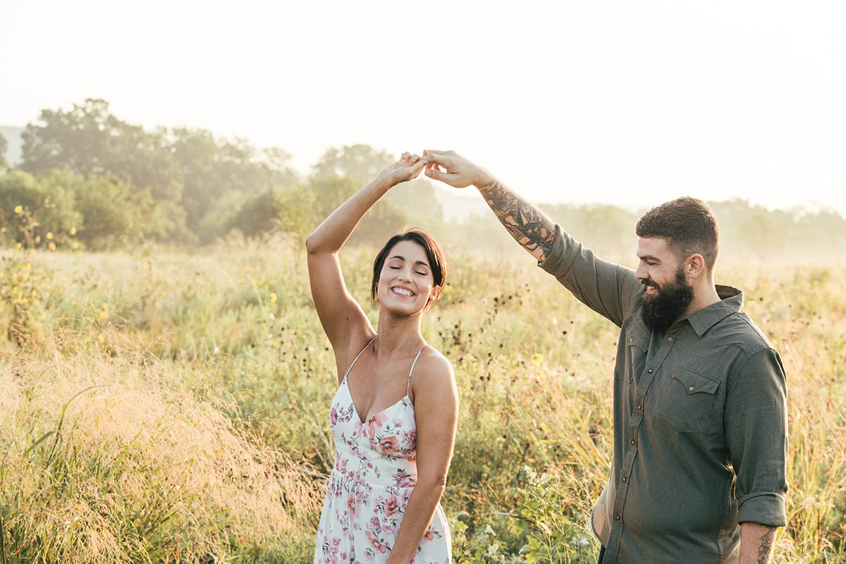engaged couple dancing tall grassy field commons ford park engagement photography