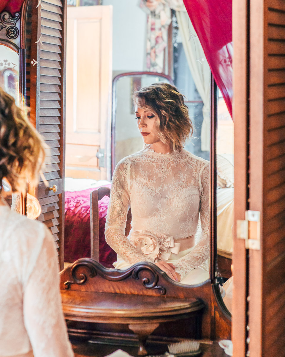 bride posing in wedding dress mirror page house georgetown texas