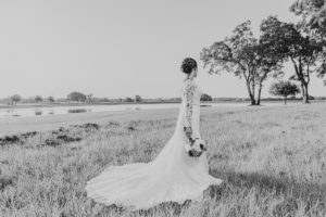 bride standing near lake eberly ranch texas black and white