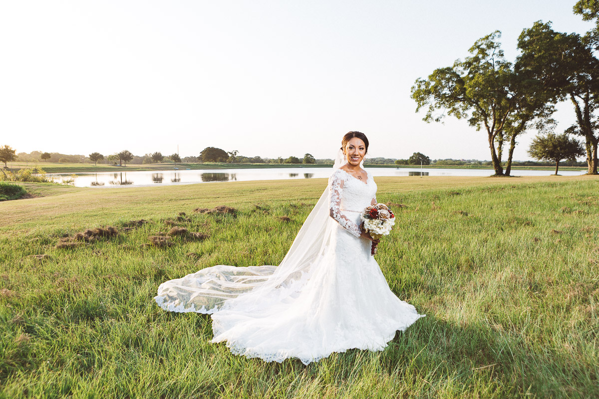 bride standing lakefront chappell hill texas