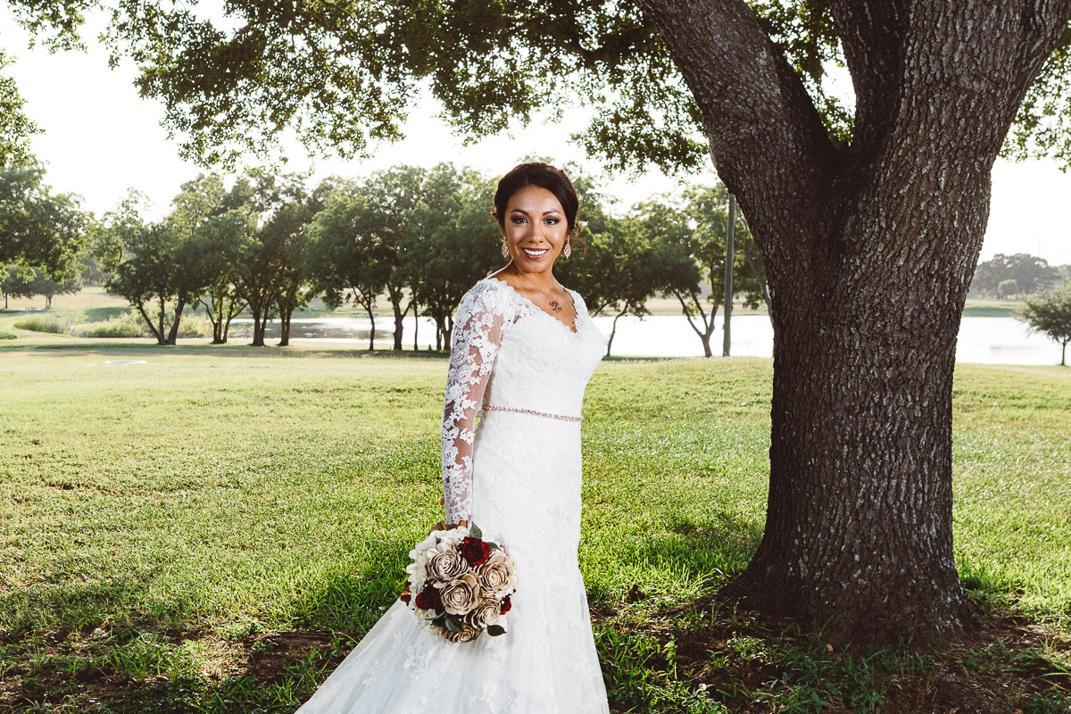 bride under tree with lake background eberly ranch texas