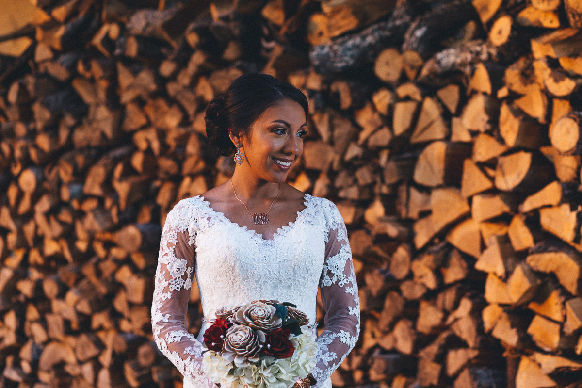 bride in front of firewood stack